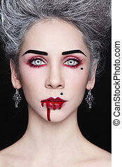 Blood beauty - Portrait of young beautiful stylish gothic...