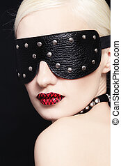 Blindness - Portrait of young beautiful woman in studded...