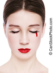 Blood tear - Close-up portrait of young beautiful girl...