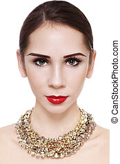 Golden necklace - Portrait of young attractive woman in...