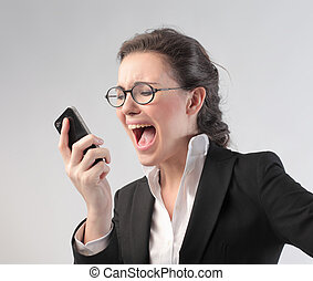 Stressed business woman yelling at phone