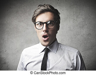 businessman surprised on gray background