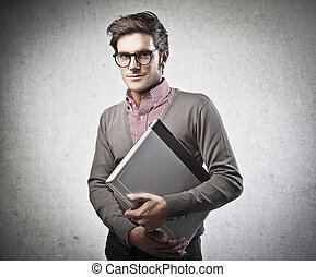 man with laptop - handsome man with laptop on gray...