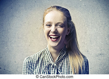 Happy woman - Young woman laughing in studio
