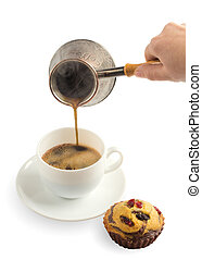 Pouring coffee in cup on white