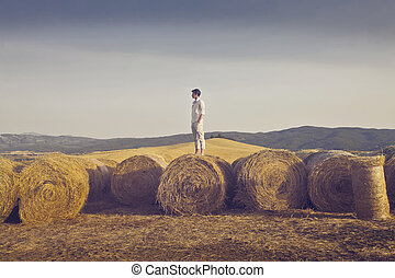 Man on haystack - Man standing on haystack