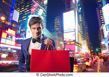 shopping - man goes shopping in a big city
