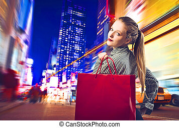 shopping  - woman goes shopping in a big city