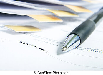 Signing a contract. Focus is on the signature and the end of...
