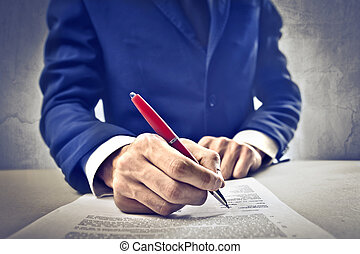 Businessman in blue suit - Businessman signing paper