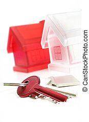House Keys - view of two keys with silver house figure on...