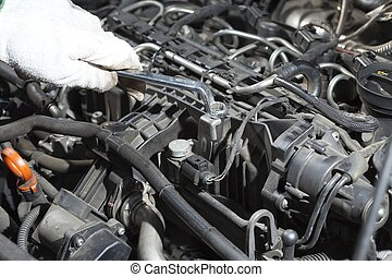 Auto Repair - Mechanic performing the maintenance of a motor...