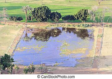 Flooded soccer field - Sodden footbal field after big flood...