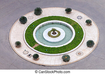 Roundabout circle with fountain and small garden