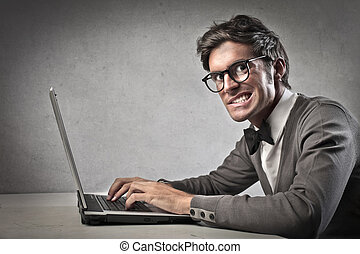 man with laptop - young man sitting at the table with laptop...