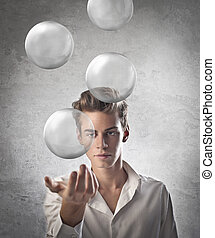 boy with spheres - young man looking spheres