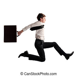 boy running - young business man running with briefcase in...