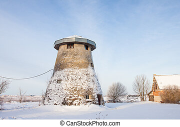 truncated windmill, a house and snow