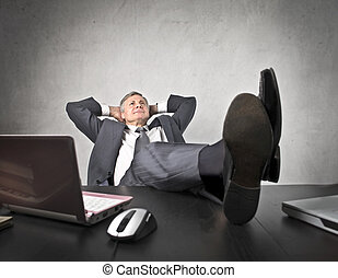 Relaxed businessman - Businessma putting his feet on the...