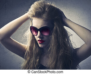 Woman in sunglasses - Woman touching her hair