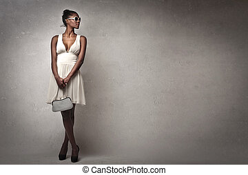 beautiful black woman with white dress on gray background