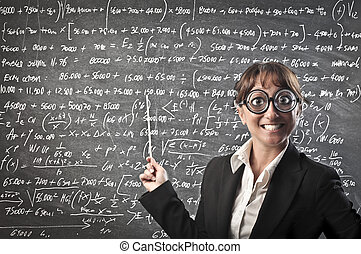 Woman teaching - Teacher in front of board