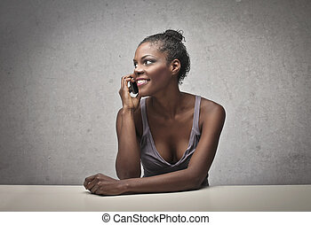 beautiful balck woman - beautiful black woman sitting at the...