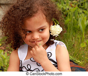 cute mixed race girl with timid expression