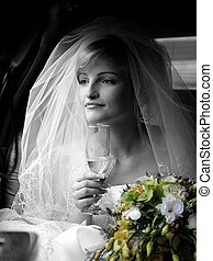 Portrait of beautiful bride in traditional wedding dress and...