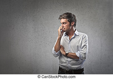 man thinks - handsome man thinks on gray background