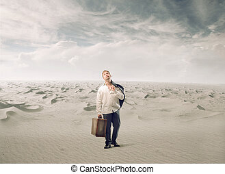 Tired man with luggage - Tired man standing in empty desert