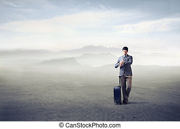 Man with lugagge - Man standing with suitcase outside