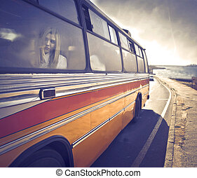 woman on the bus - blonde woman sitting on the bus