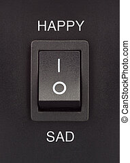 Switch - Happy or Sad black toggle switch on black surface...