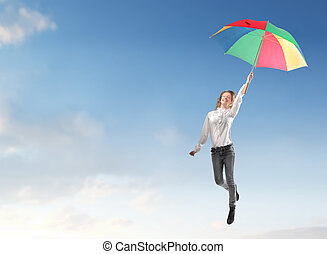 happy woman flying in the sky with umbrella
