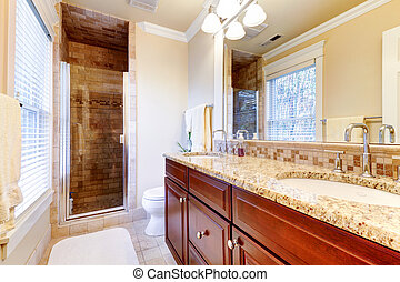 Large bathroom with cherry cabinets and granite countertop....