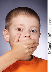 I dont speak - Portrait of boy closing his mouth with hand
