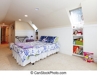 Girl bedroom with attic ceiling and beige carpet with toys....