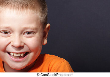 Wide smiling face - Portrait of boy with wide smile over...