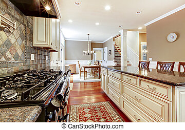 White luxury kitchen with stone, tiles large stove.