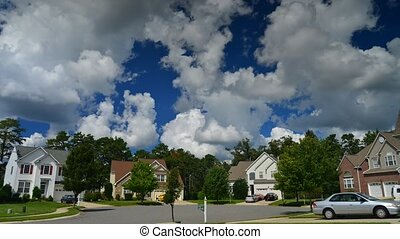 Time lapse of idyllic suburbs with homes on a cul de sac and...