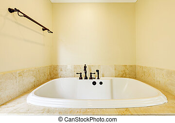 Nice empty bathroom with large white tub