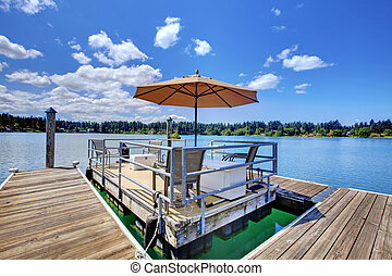 Lake with wood pier and private party raft.