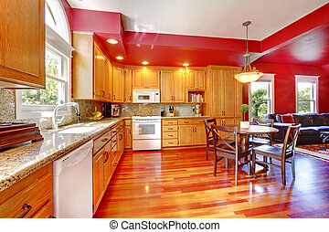 Red beautiful large kitchen with cherry hardwood.