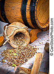 Grains with hops - Grains with hop on table by the beer...
