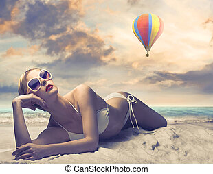 relax on the beach - beautiful woman with bikini relaxes...