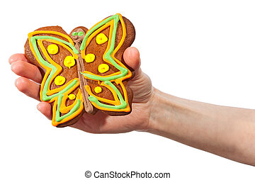 Gingerbread butterfly in hand