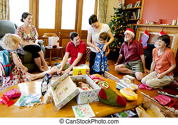 Christmas - Xmas Holiday - Family opens presents at cozy...
