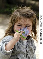 Girl smell flower
