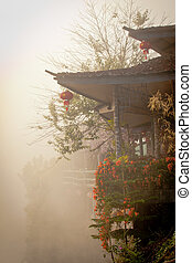 Chinese house in fog - View of chinese house among the fog